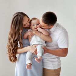 A couple holding their baby achieved through IVF with the help of AI machine learning | Reproductive Science Center of The San Francisco Bay Area