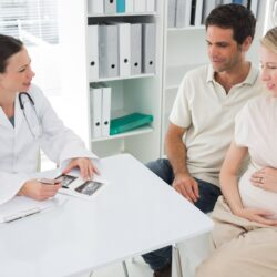 doctor talking with fertility patients who are expecting | Reproductive Science Center of the San Francisco Bay Area