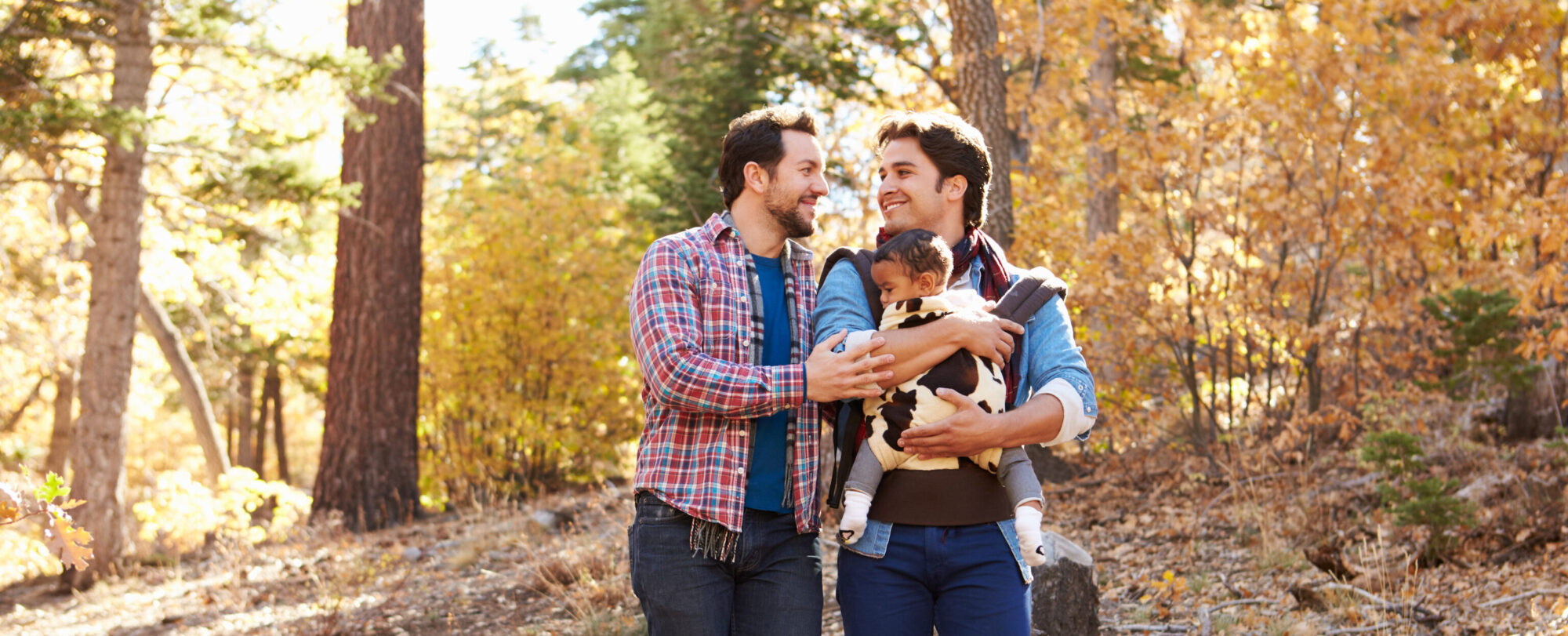 LGBTQ+ couple walking with baby