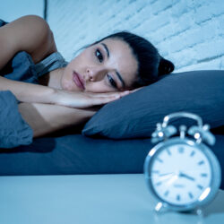 Woman in bed suffering from insomnia | RSC SF Bay Area | CA