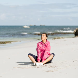 Early miscarriage | RSC SF Bay Area | Woman sitting on the beach