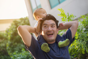 Happy father and son outside | Male Infertility | Reproductive Science Center of the Bay Area