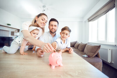 young family puts money in piggy bank saved through CapexMD's financing assistance | Reproductive Science Center of the San Francisco Bay Area