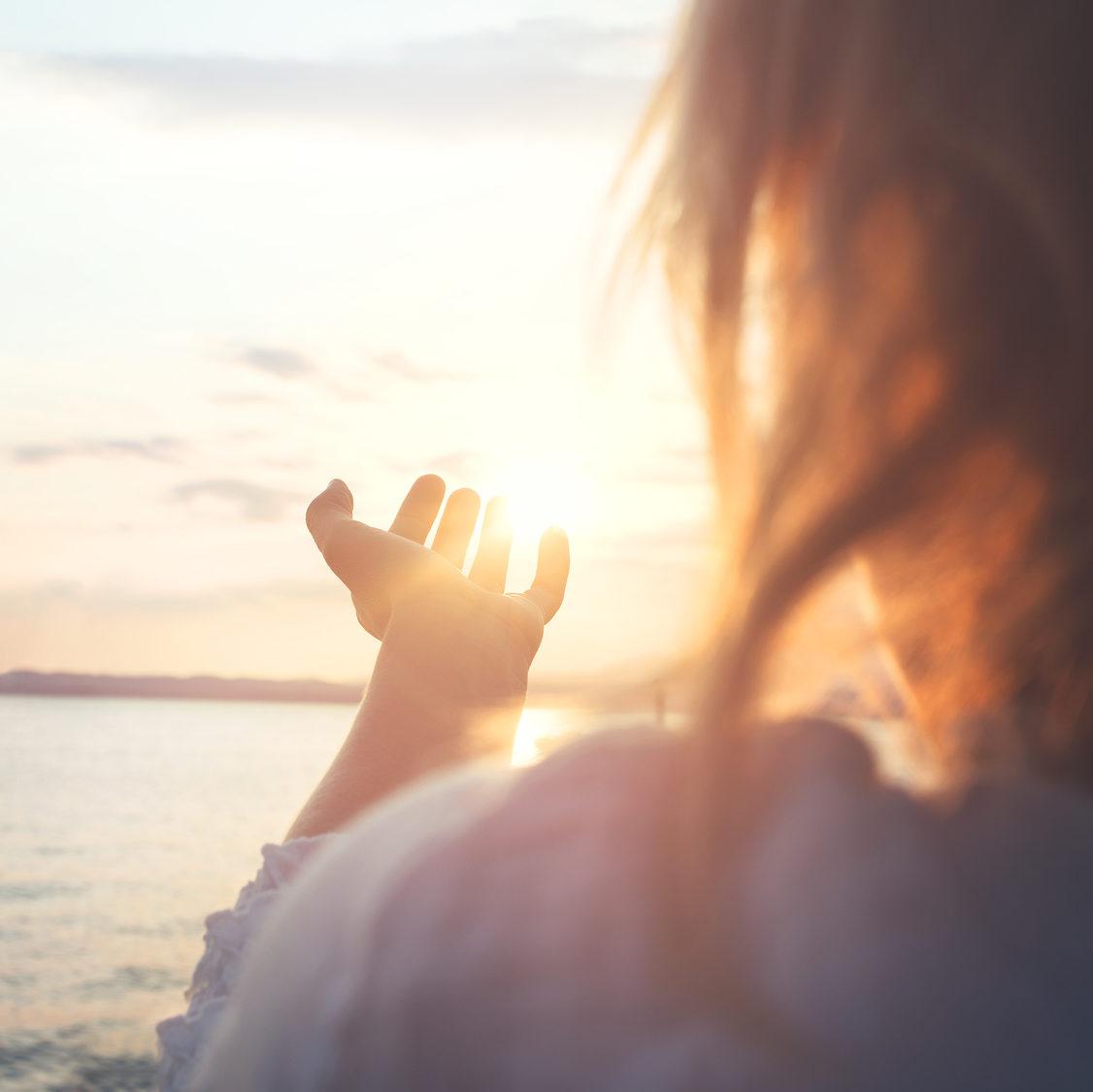 Vitamin D & uterine fibroids| RSC Bay Area | photo of woman reaching toward the sun